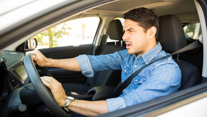 Illustration for article titled Societal Collapse Narrowly Averted After Man Honks Horn At Car Paused At Green Light