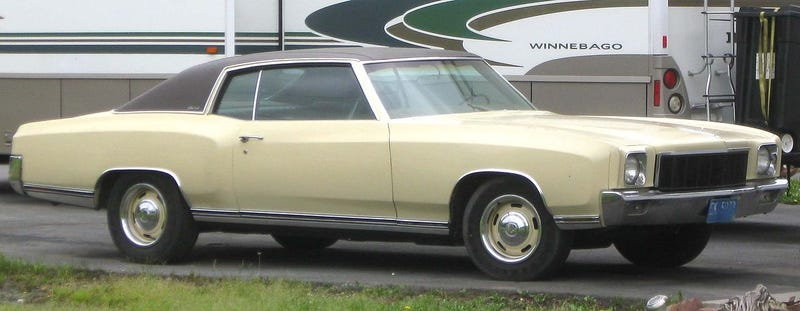 Like this but with rust over the wheelarches, a peeling vinyl top, rusting steelies, and faded orange paint.