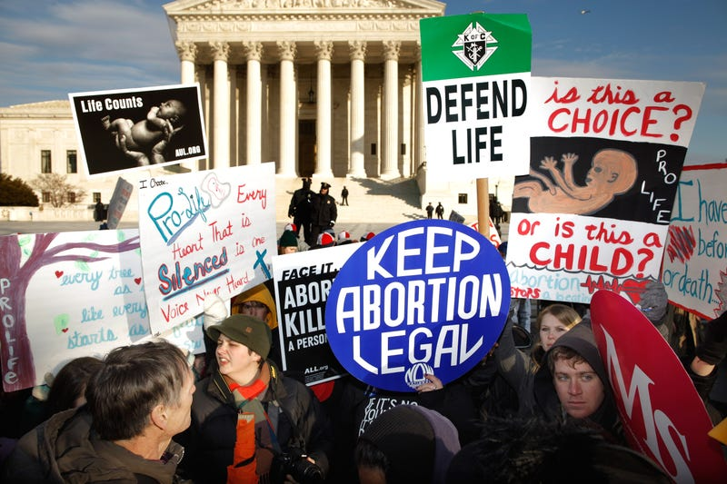 Pro-life and pro-choice demonstrators argue in front of the Supreme Court during the March for Life on Jan. 24, 2011, in Washington, D.C. Chip Somodevilla/Getty Images