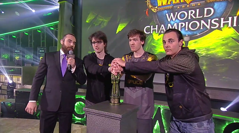 The three members of Splyce's World of Warcraft team gripping the trophy after winning the championship.
