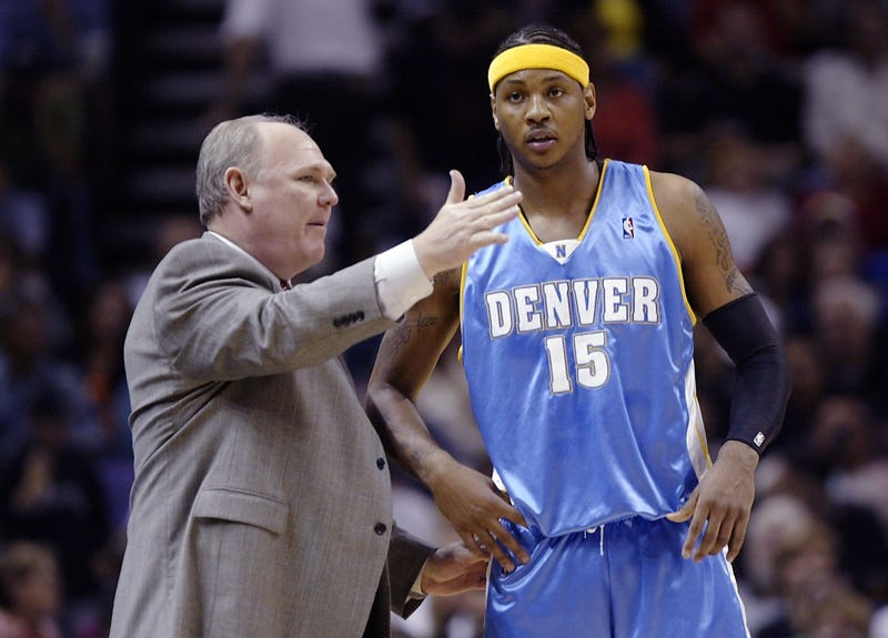 Then-head coach George Karl of the Denver Nuggets talks with Carmelo Anthony April 27, 2005, during their game against the San Antonio Spurs during the 2005 NBA Western Conference first round in San Antonio.Brian Bahr/Getty Images