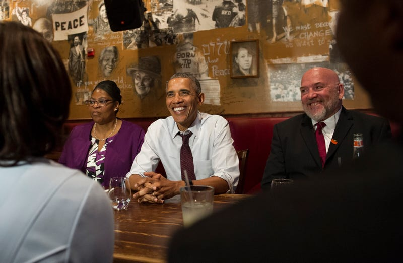 President Barack Obama speaks to the media after having lunch with formerly incarcerated individuals who have received commutations, including Ramona Brant (left) and Phillip Emmert (right), at Bus Boys and Poets restaurant in Washington, D.C., on March 30, 2016.Kevin Dietsch-Pool/Getty Images