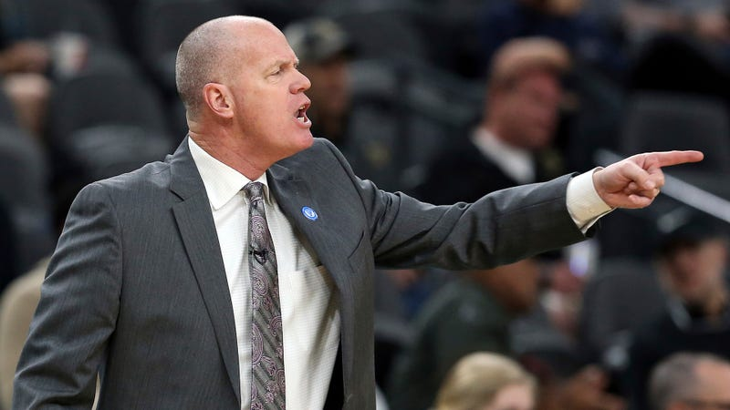 Illustration for article titled Colorado Coach Tad Boyle Injures Leg While Breaking Up Scuffle After Late-Game Dunk