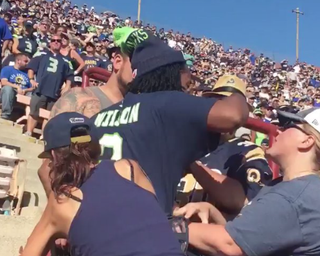 A fight between a Seattle Seahawks fan and several Los Angeles Rams broke out Sept. 18, 2016, in the Los Angeles Memorial Coliseum.Twitter