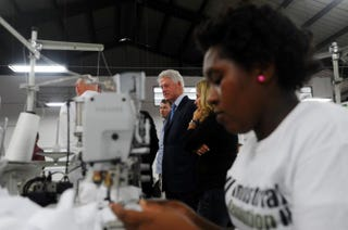 Former President Bill Clinton visits a clothing manufacturer in the SONAPI Industrial Park in Port-au-Prince, on Feb. 18, 2014.HECTOR RETAMAL/AFP/Getty Images