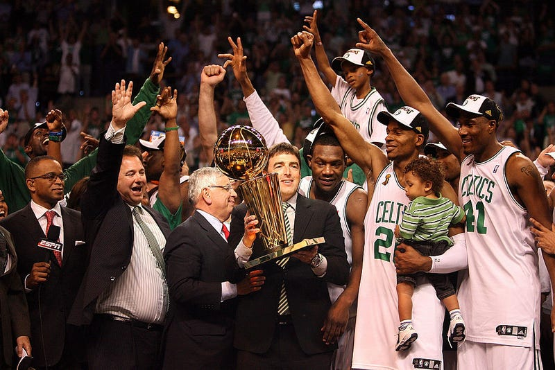 f0691b65dc3 Boston Celtics owner Wyc Grousbeck (holding trophy) celebrates after team  defeats the Los Angeles