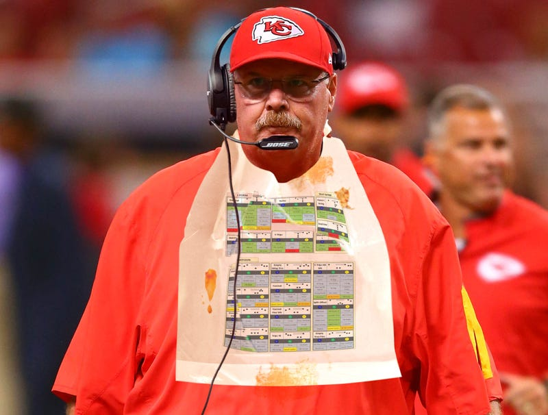 Illustration for article titled Andy Reid Carefully Consults Plastic Bib With Chiefs Offensive Plays