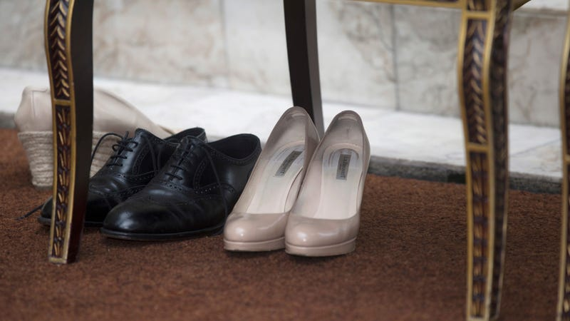 Kate's shoes removed during a mosque visit in Malaysia.