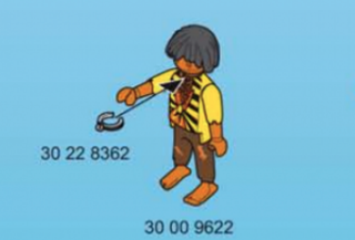 Image from a Playmobil pirate-ship instruction manual that shows the buyer how to properly place a slave collar on the black character's neck  CBS Sacramento Screenshot