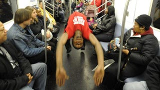 "New York City subway dancer Tamiek ""B/Boy LJ"" Steele performs with other members of his dance crew on Nov. 23, 2010.TIMOTHY A. CLARY/AFP/Getty Images"