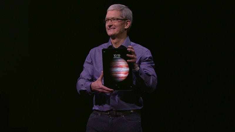 Apple CEO Tim Cook holds the new iPad Pro