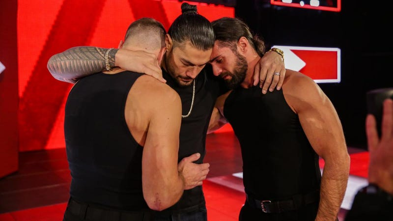 Dean Ambrose, Roman Reigns, and Seth Rollins embrace on Monday after Reigns announced that he's been diagnosed with a relapse of leukemia.