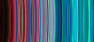 Illustration for article titled Saturn's Rings as a Cosmic Rainbow