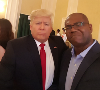 The Root Political Editor Jason Johnson (right) with a Donald Trump impersonator at Politicon (Jason Johnson/The Root)