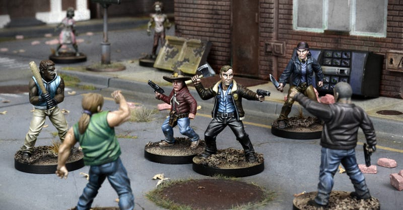 Illustration for article titled Roll Dice to Smash In Zombie Heads With the Walking Dead Tabletop Miniatures Game