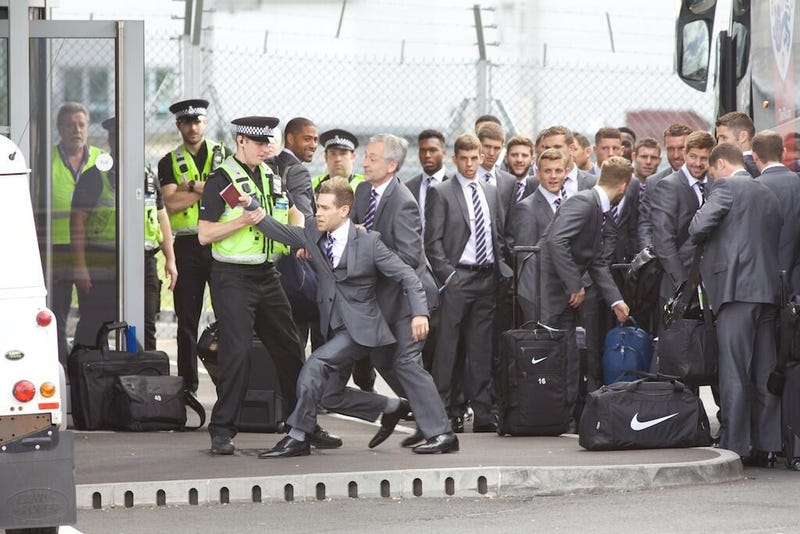 Illustration for article titled British Comedian Almost Sneaks On Team England's World Cup Plane