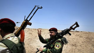 Illustration for article titled Fegyverrel támogatná az iraki kurdokat Berlin és Róma