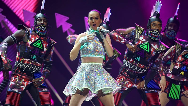 Katy Perry backed by some dancers in...outfits in 2015. Image Getty