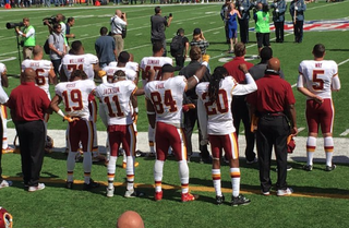 Washington Redskins players raise their fists during the national anthem at the Sept. 25, 2016, game against the New York Giants.Twitter