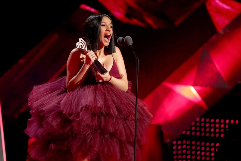 Cardi B wears Christian Siriano to accept the award for Best New Artist at the 2018 iHeartRadio Awards.