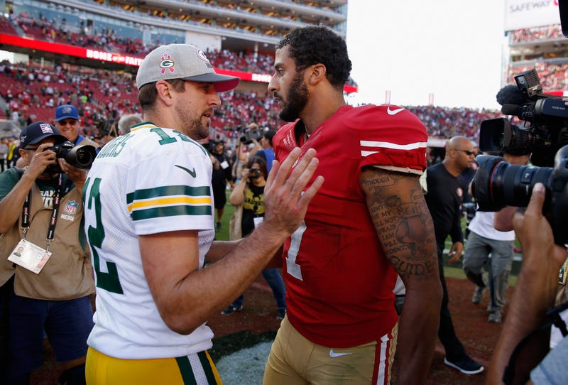 Aaron Rodgers of the Green Bay Packers talks with Colin Kaepernick, then of the San Francisco 49ers, after their game at Levi's Stadium on Oct. 4, 2015, in Santa Clara, Calif. (Ezra Shaw/Getty Images)