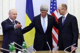 Oleksandr Turchynov, Ukraine's interim president; U.S. Secretary of State John Kerry; and Ukrainian Prime Minister Arseniy Yatsenyuk in Kiev on March 4, 2014YURY KIRNICHNY/AFP/Getty Images