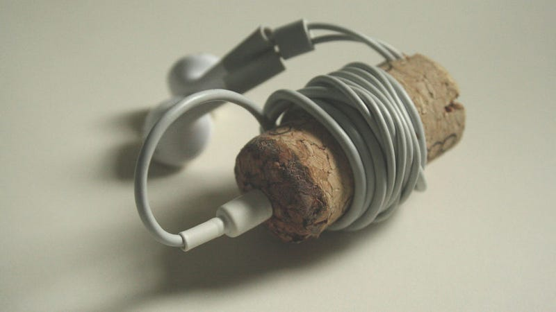 Illustration for article titled Turn a Wine Cork Into a Wrap-Around Earbud Holder
