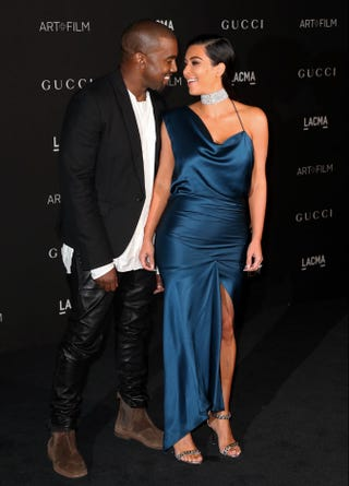 Illustration for article titled Caption This and Tell Us What Kimye Are So Overjoyed About