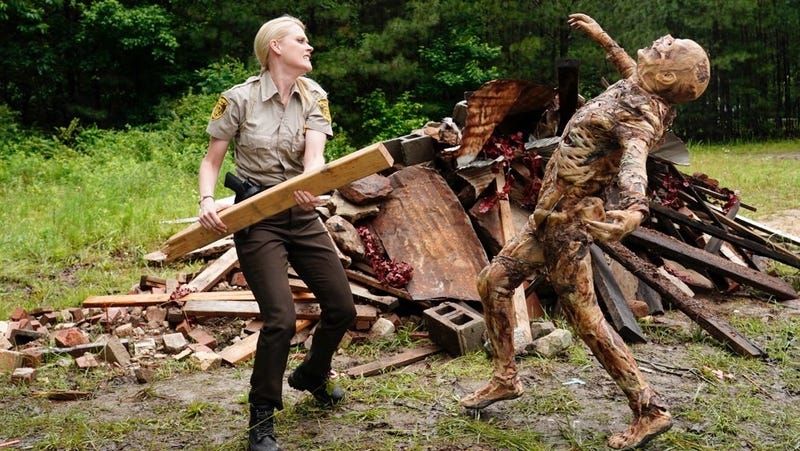 Evie Barret (Janet Varney) clobbers a creeper in the Stan Against Evil season premiere.