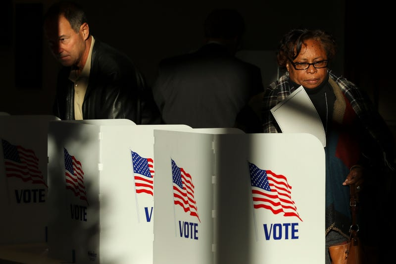 Voters cast their ballots at a polling place at Highland Colony Baptist Church, November 27, 2018 in Ridgeland, Mississippi.
