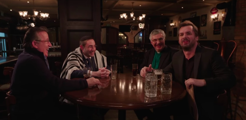 Illustration for article titled Drunk atheist Jim Jefferies tries to broker Middle East peace with a trio of churchy types