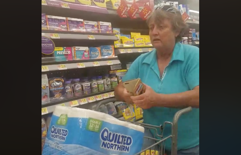 This Wal-Mart customer may be banned from the store for life after video footage that shows her going on a racist rant against a Latina and a black woman. (Eva Hicks via Facebook)