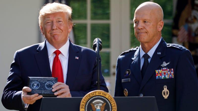 Gen. John Raymond gave President Donald Trump a plaque at the U.S. Space command re-establishment ceremony