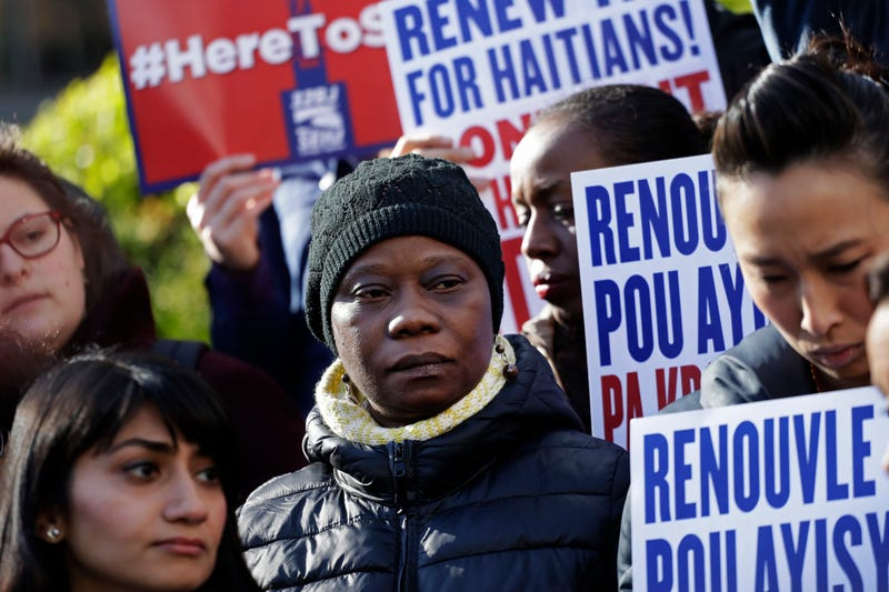 Immigration advocates rally in New York on Tuesday, Nov. 21, 2017, to protest the decision from the Department of Homeland Security to terminate Temporary Protected Status for people from Haiti.  (Mark Lennihan/AP Images)