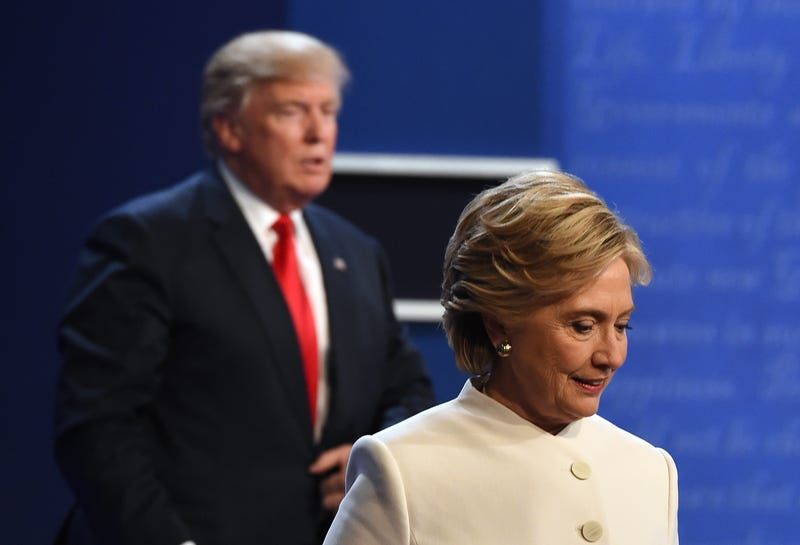 Republican nominee Donald Trump and Democratic nominee Hillary Clinton walk off the stage after the final presidential debate at the Thomas & Mack Center on the campus of the University of Las Vegas on Oct. 19, 2016.  ROBYN BECK/AFP/Getty Images
