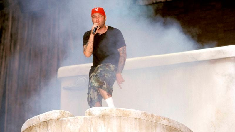 Fred Durst climbing out of a giant toilet at Ozzfest in 1999 (Photo  George  De Sota Redferns Getty Images) 7b821021129