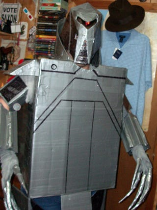 Illustration for article titled A Cardboard Cylon and Some Superhero Hotness