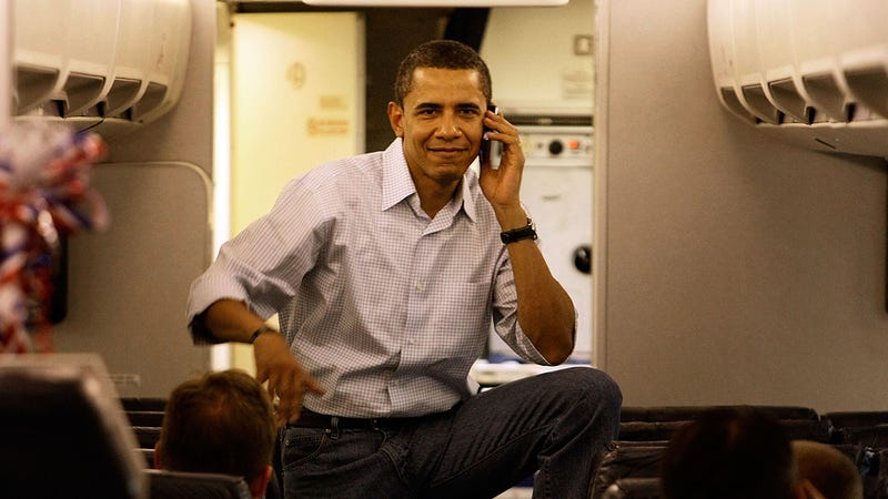 Barack Obama talking on the phone on a plane in 2008 | Image: Getty