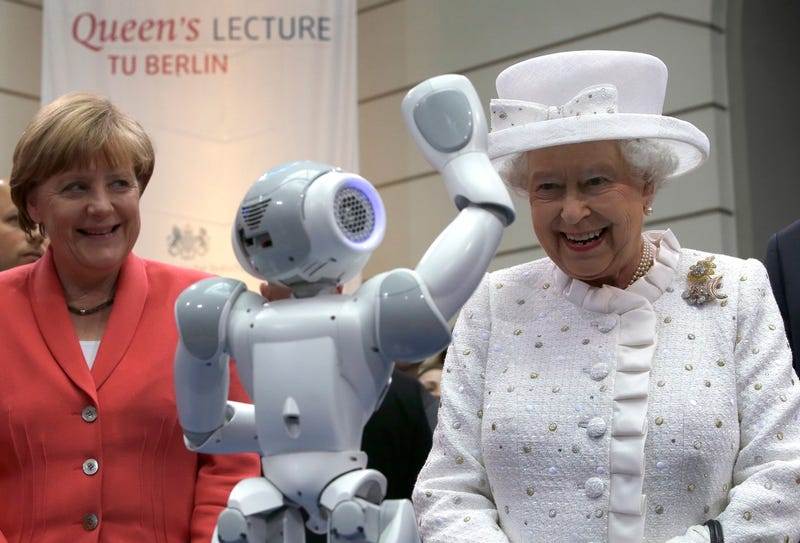 Illustration for article titled Queen Elizabeth Meets the Future Queen Who Is A Robot And Not A Human
