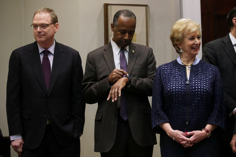Housing and Urban Development Secretary Ben Carson looks at his watch as he waits with Small Business Administration Administrator Linda McMahon (R) and Chairman of the Council of Economic Advisers Kevin Hassett prior to a Roosevelt Room event at the White House February 6, 2019 in Washington, DC.