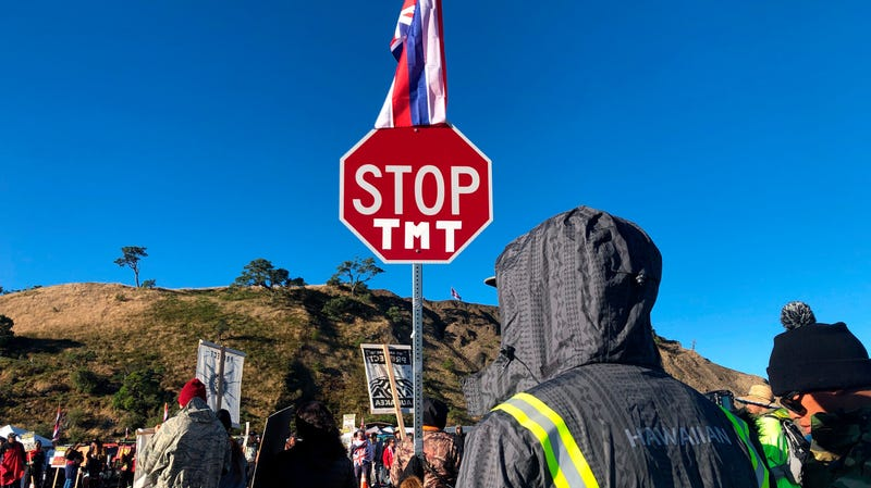 Demonstrators gather to block a road at the base of Mauna Kea in Hawaii July 15, 2019 to protest the construction of a giant telescope.