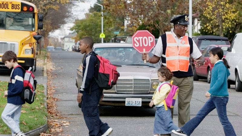Illustration for article titled 8 Local Crossing Guards I've Got Wrapped Around My Little Finger