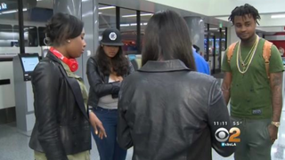 Several passengers are shown waiting inside a terminal at Los Angeles International Airport after they were forced to leave Spirit Airlines Flight 868 Nov. 2, 2015, for protesting a flight attendant's treatment of a black couple.CBS News Screenshot