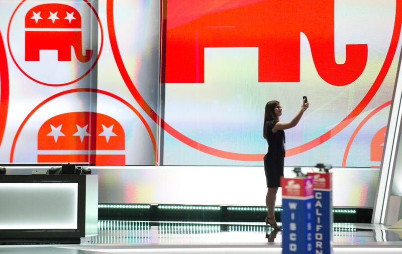 A woman takes a selfie from the stage as preparations get underway for the Republican National Convention at the Quicken Loans Arena in Cleveland, Ohio on July 17, 2016. An estimated 50,000 people are expected in Cleveland, including hundreds of protesters and members of the media. The four-day Republican National Convention kicks off on July 18.Jeff Swensen/Getty Images