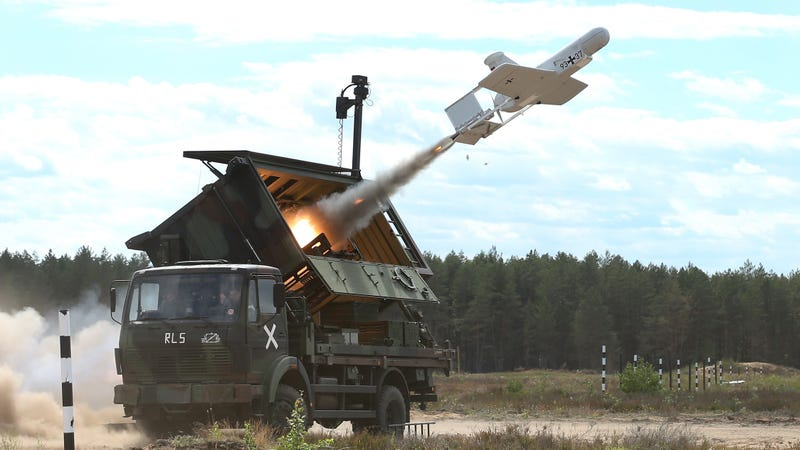 A KZO reconaissance drone of the Bundeswehr, the German armed forces, launches with the help of a booster rocket during Thunder Storm 2018 multinational NATO military exercises on June 7, 2018 near Pabrade, Lithuania.