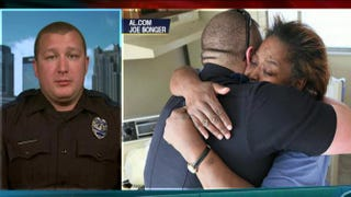 Police Officer William Stacy (in left frame, and right, being hugged by Helen Johnson). Stacy let Johnson go after she was caught stealing eggs to feed her family. Fox News screenshot