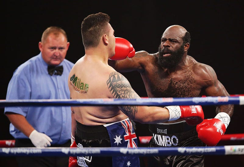 Kimbo Slice (right) fights Shane Tilyard during a bout  Jan. 30, 2013, in Sydney.  Matt King/Getty Images