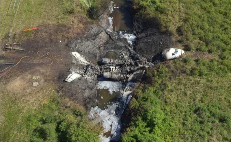 The charred remains of Gulfstream IV N121JM. The crash killed all six passengers and crew. (Massachusetts State Police/NTSB)