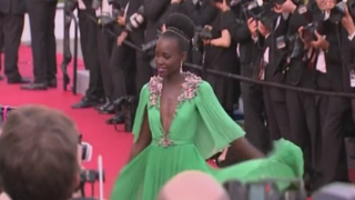 Actress Lupita Nyong'o—style icon—gives a twirl for the cameras at Cannes.Belfast Telegraph UK Screenshot