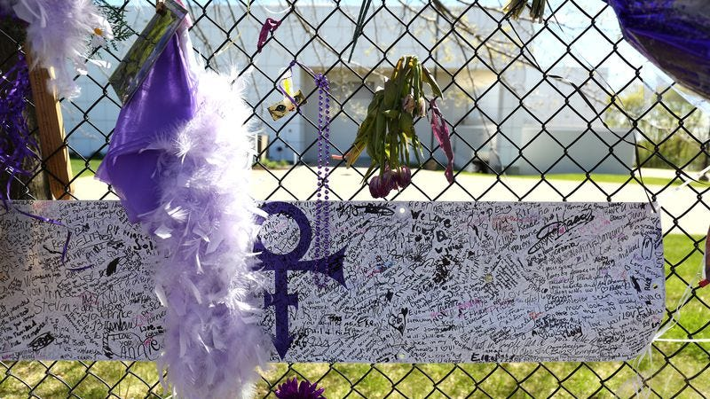 A tribute built on the fence of Prince's Paisley Park Estate. (Photo: Adam Bettcher/Getty Images)